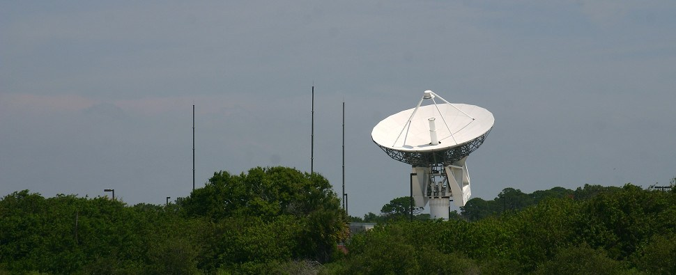 Gator Watcher: A tracking satellite dish hovers over the Florida Everglades
