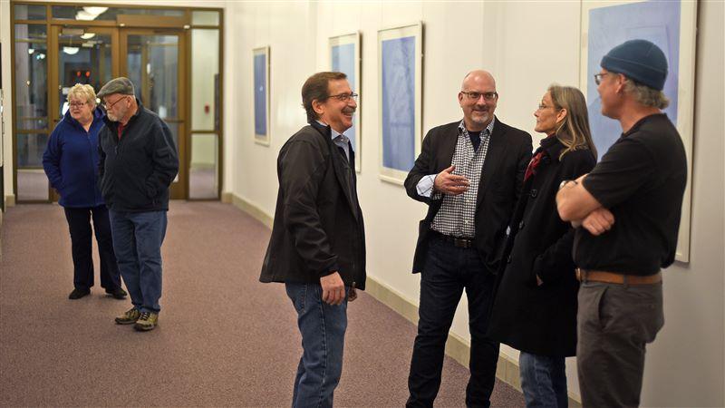 Scott Patria visits with Weber State University professor